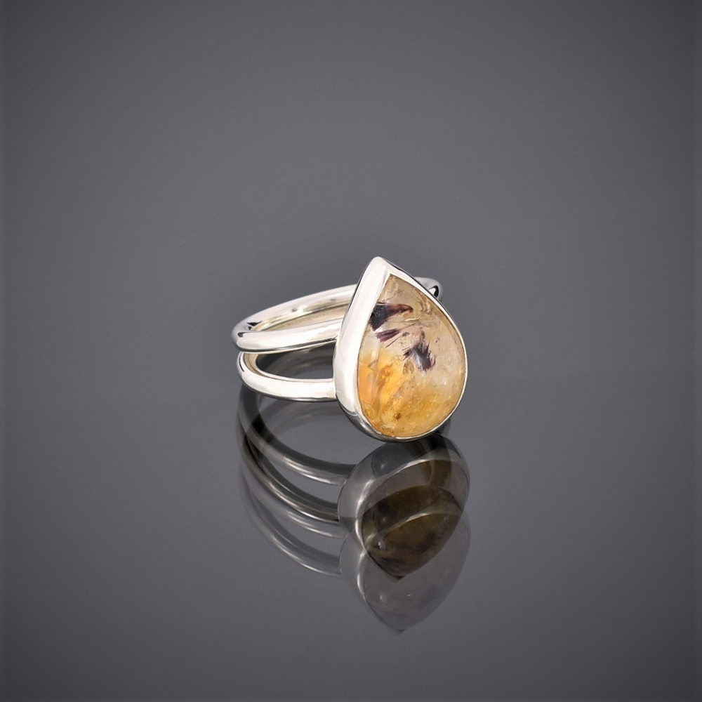 Ring made of a teardrop citrine with ruby mica inclusions on a double silver round wire shank.