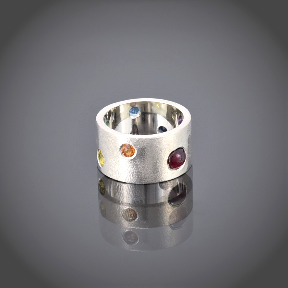 Wide frosted silver band with multi-coloured stones