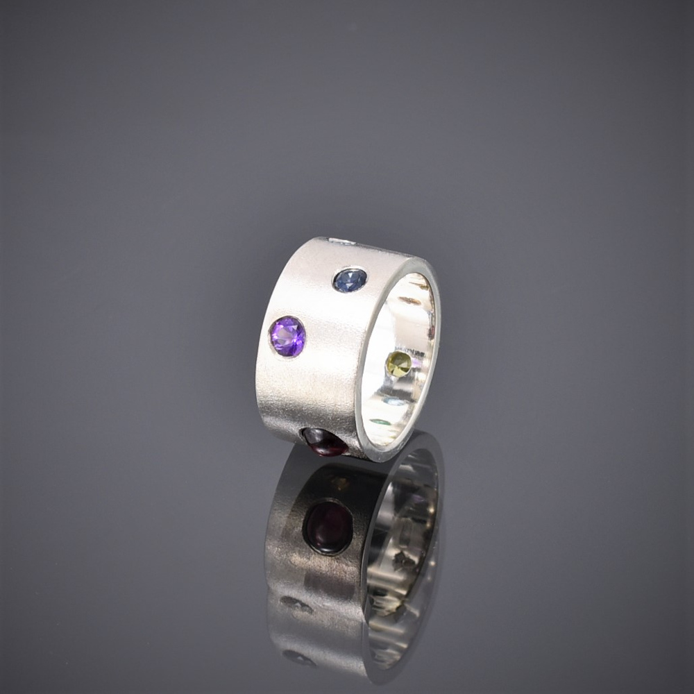 Wide frosted silver band with multi-coloured stones, amathyst topaz showing
