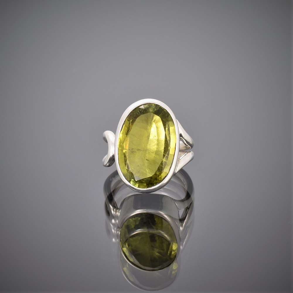 Chunky oval peridot and silver wire ring. Peridot set in rubover setting.
