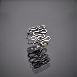 An oxidised silver ring made of one squiggly piece of wire.