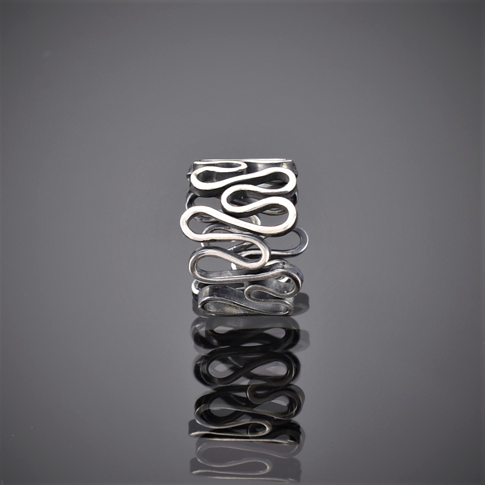 Front view of an oxidised silver ring made of one squiggly piece of wire.