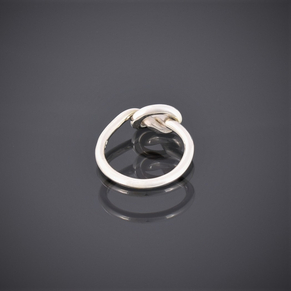 Back view of a solid silver wire ring 1formed in a knot to represent friendship