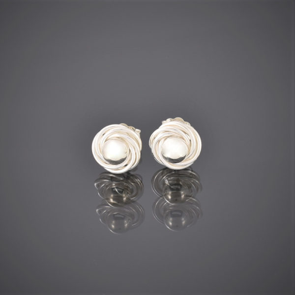 Solid silver stud earrings made of a bead surrounded by silver wire swirls