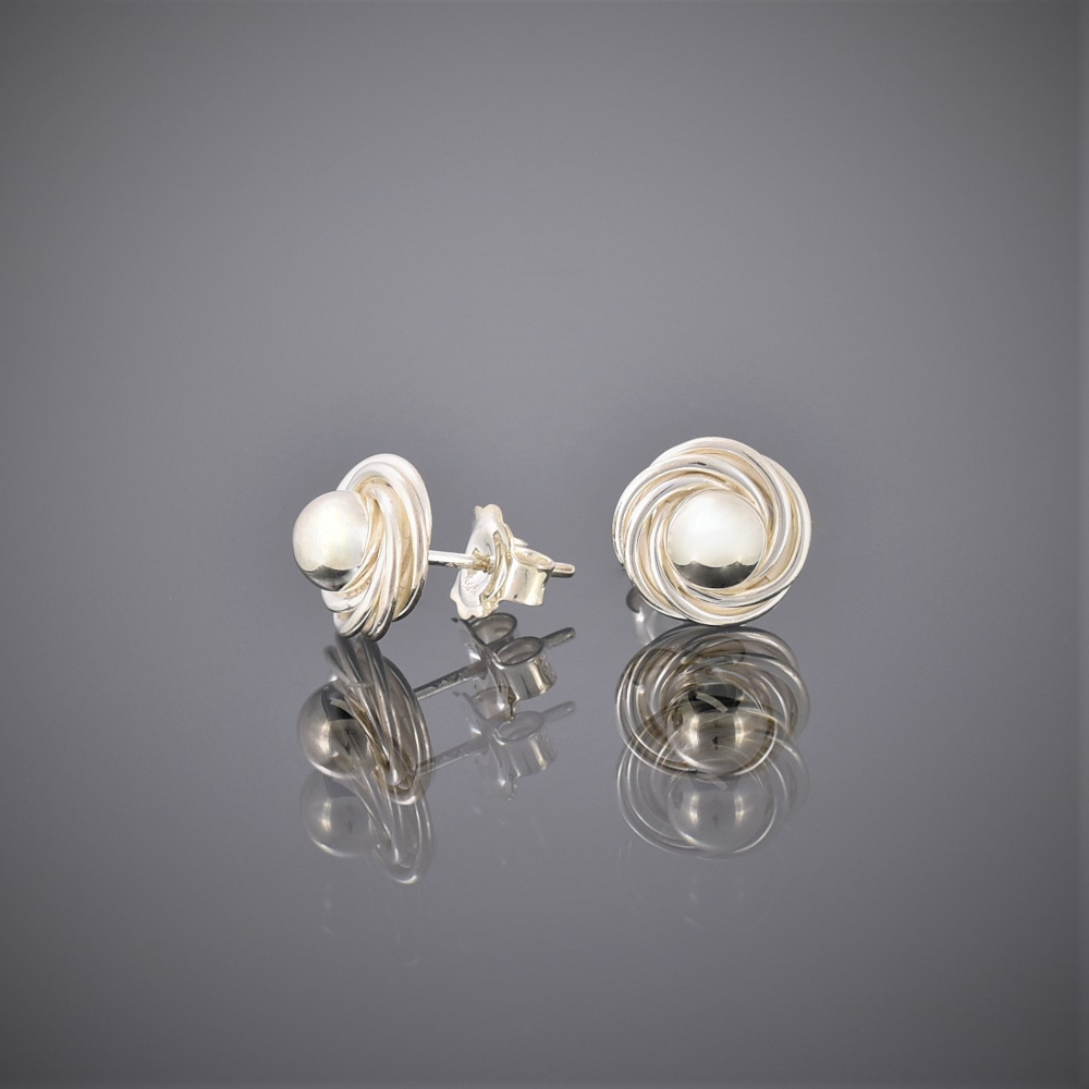 Side view of solid silver ball and swirl earrings showing peg and butterfly