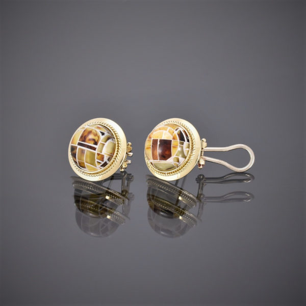 Left view of round 18ct gold sling back earring with amber mosaic center