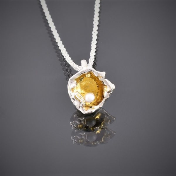 Front view of gold plated water cast silver pendant with freshwater pearl on chain