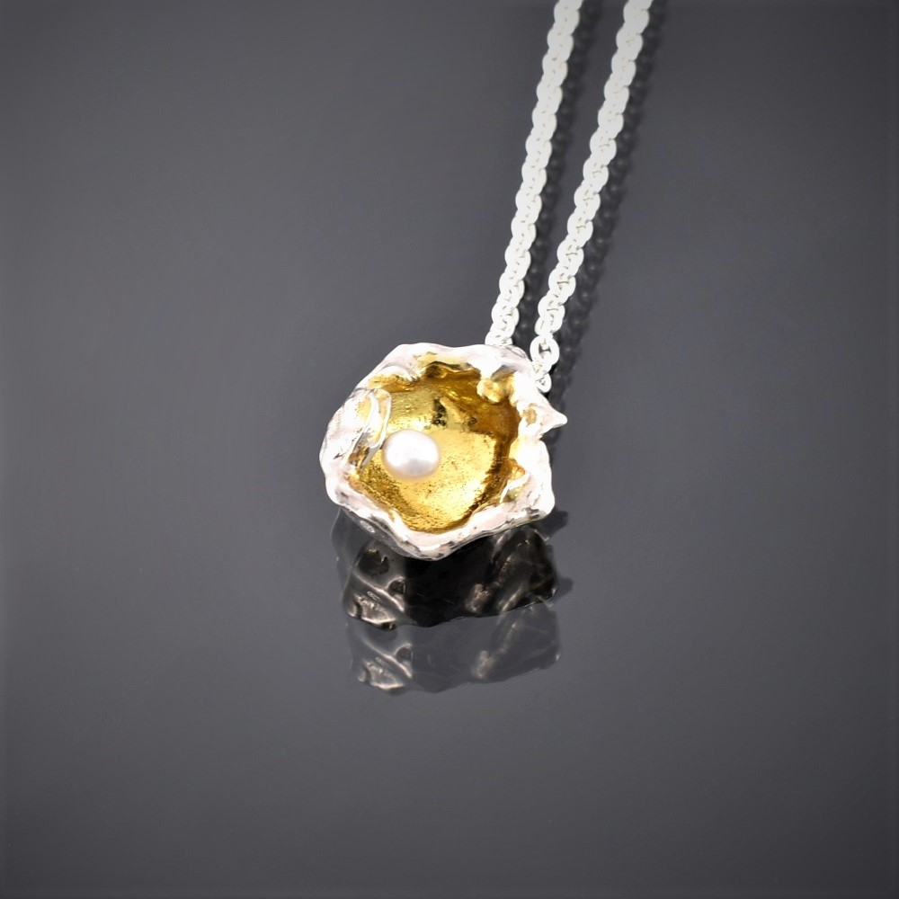 Gold plated water cast silver pendant with small freshwater pearl