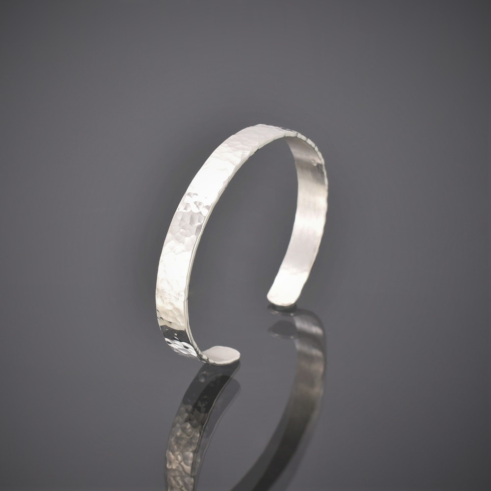 Right view of a narrow hammered finish solid silver cuff