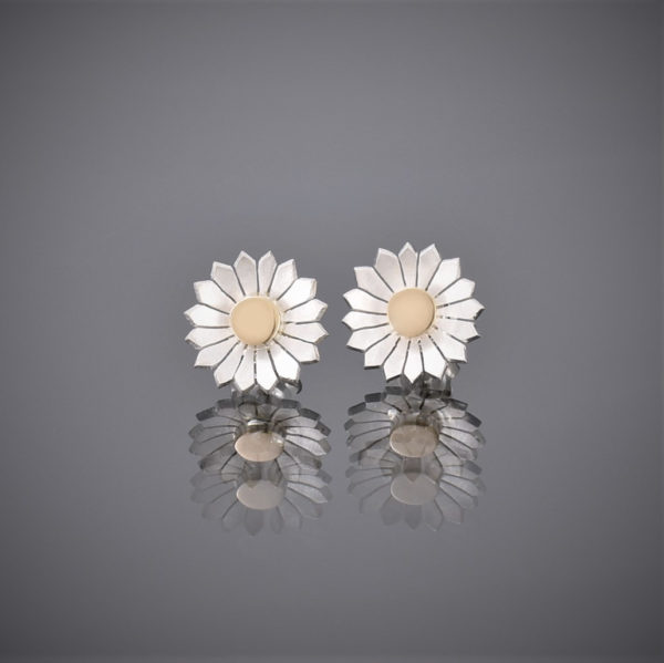 A pair of brushed silver daisy stud earrings with a solid 18ct gold centre.
