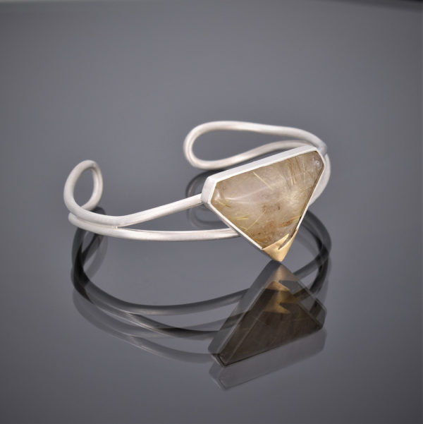 Silver wire cuff with a triangular rutilated quartz stone and 24ct gold detail