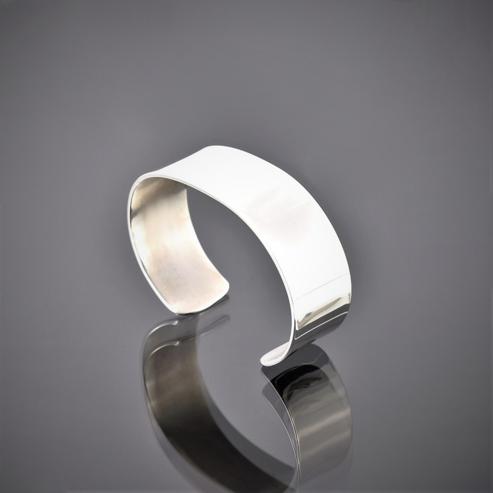 Left view of a highly polished wide solid silver cuff