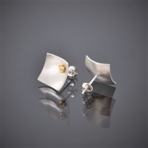 Back and front view of concave square brushed silver stud earrings with a very little 22ct yellow gold flower in the corner