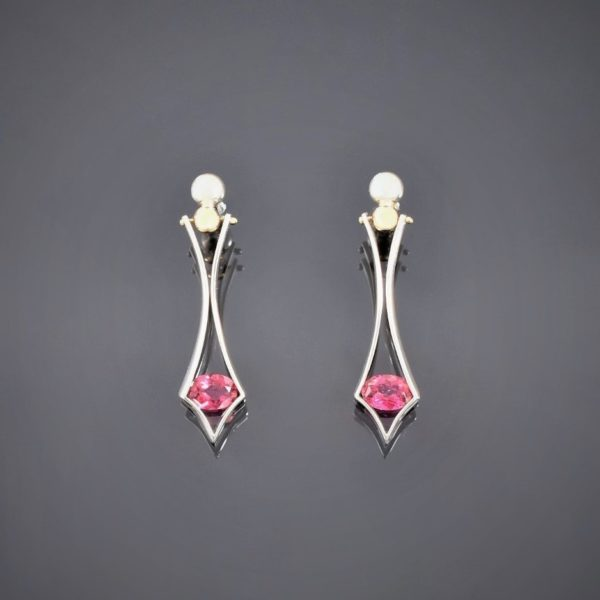 Silver and gold tension set tourmaline drop earrings. Secured with ball & stud
