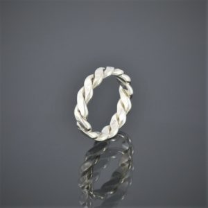 Left view of double twisted hammered silver ring