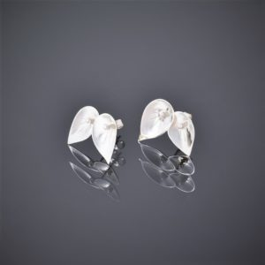 Left view of a pair of polished silver double leaf shaped stud earrings