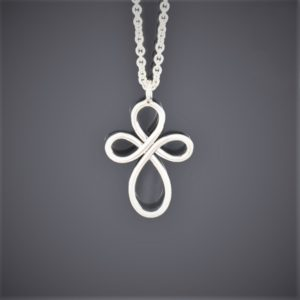 A single piece of round silver wire formed into an infinity cross on silver chain