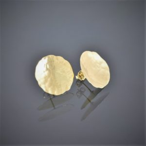 Front view of a pair of 18ct yellow gold stud earrings. The gold is thin, slightly concave with a beaten finish